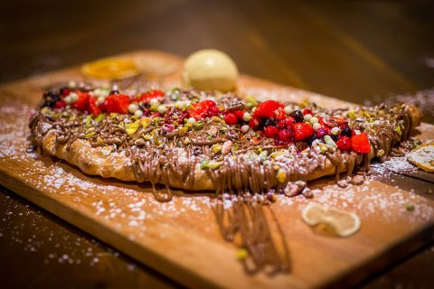 Crepes with nutella, nuts and berries