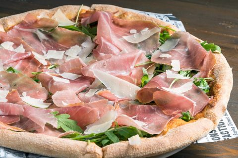 Italian Pizza with prosciutto in Glyfada